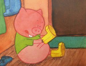 Bo som gris tar på gummistøvler.